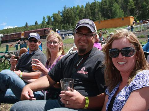 Sipping beer at the Rails & Ales Brewfest after a ride on the Rio Grande Scenic Railroad in Alamosa, Colorado