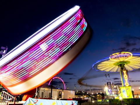 Colorful rides at night during the Illinois State Fair in Springfield