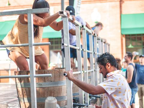 Stomping grapes to make wine during GrapeFest in Grapevine, Texas